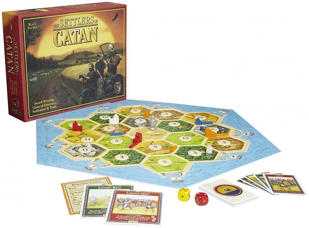 Caixa, componentes e tabuleiro do jogo Catan